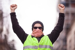 yellow vest political activist protesting on street