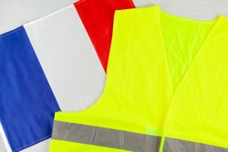 Yellow vests, as a symbol of protests in France. Yellow jacket with the flag of France