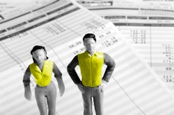 yellow vests man and woman minitature on pay sheets background, france