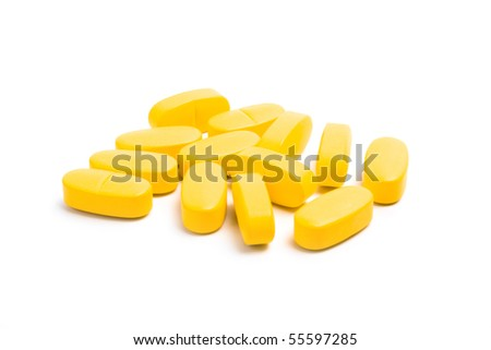 yellow vitamin pills isolated on white background