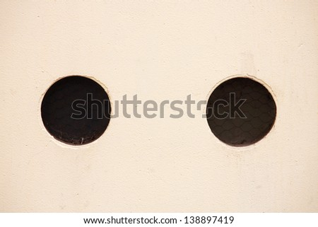yellow wall with black holes