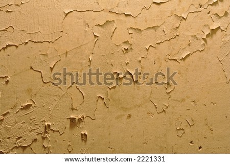 Yellow wall with cracked and pealing paint