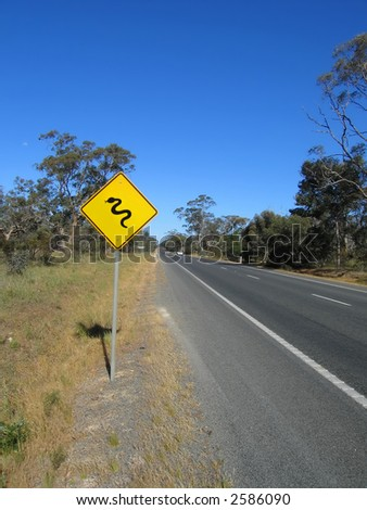 "Yellow warning road sign ""Beware of snakes"" - stock photo"