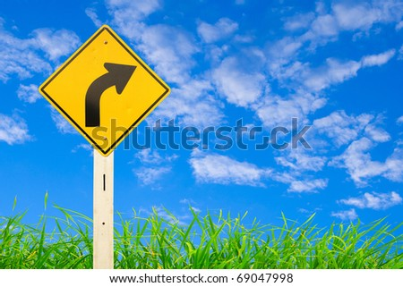 Yellow warning sign of curved right