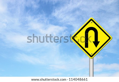 Yellow warning sign u-turn roadsign with blue sky background blank for text