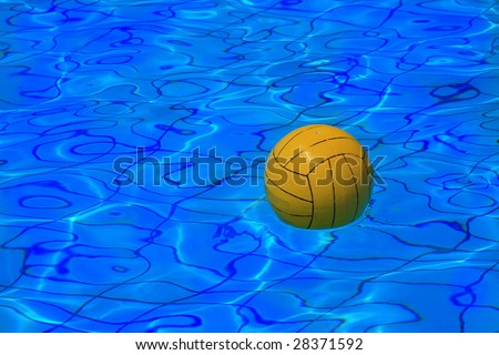 stock photo : Yellow water polo ball on blue water background