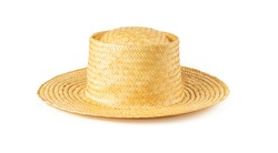 Yellow wide brim straw hat isolated on white background. Summer female vintage classic headwear. Stylish modern eco-friendly accessory for beach, vacation and travel. Front view.