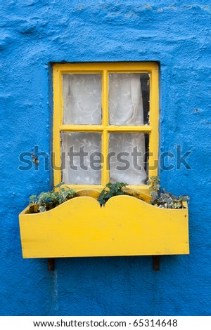 Yellow window on a blue wall. Ireland