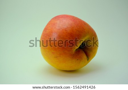 Yellow with red apple picture on a white background