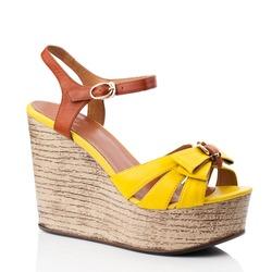 Yellow  women shoe isolated on white background.