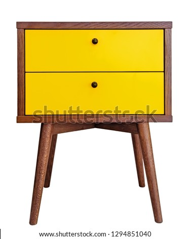 Yellow wood bedside table. Modern designer nightstand isolated on white background front view. cabinet with two drawers stock photo