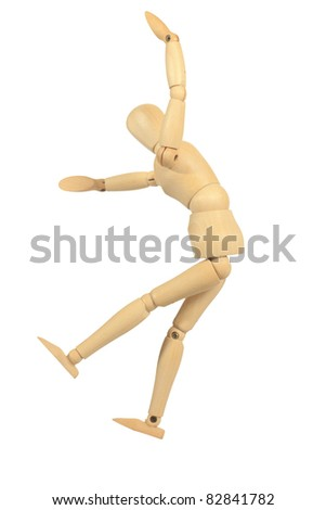 Yellow wooden dummy in bounce action isolated on white background