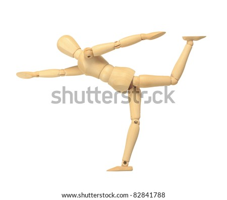 Yellow wooden dummy in yoga action isolated on white background