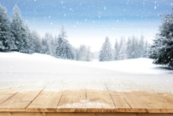 yellow wooden old table place with snow and landscape of trees and sky