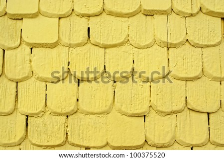 Yellow wooden shingles - Wooden shingles freshly covered with yellow paint used as wall covering.