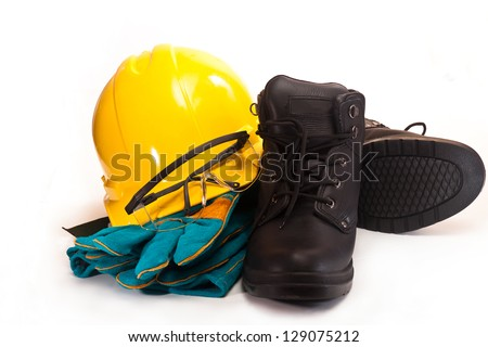 Yellow working hard hat, goggles, gloves and work boots on a white background