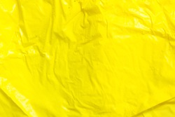yellow wrinkled plastic fabric