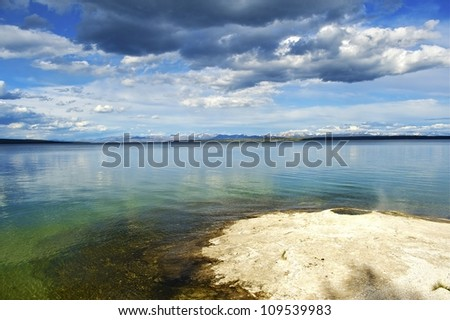 Yellowstone Lake with Geyser. West Thumb Geysers Basin, Yellowstone National Park, Wyoming USA. Calm Waters of the Yellowstone Lake