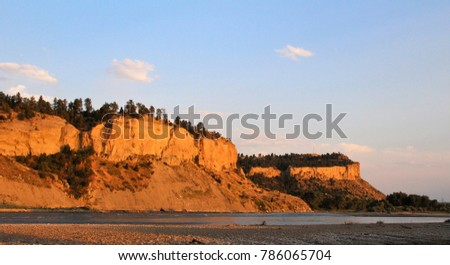 Shutterstock Yellowstone River and Sacrifice Cliff of the Rimrocks at Sunset in Billings Montana during Summer.