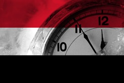 Yemen, Yemeni flag with clock close to midnight in the background. Happy New Year concept