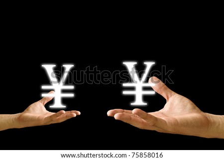 Yen icon in the hands - stock photo