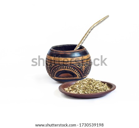 Yerba mate in calabash and dry herb in clay bowl isolated on white background Stockfoto ©