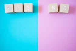 Yes and No; Five wooden blocks with YES NO text of concept.