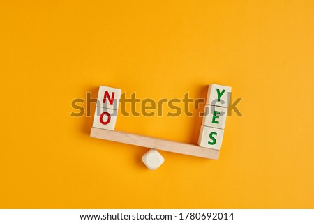 Yes and no inscription on wooden cubes on a seesaw with yes outweighs no. The concept of positivity or positive attitude in life. Stock photo ©