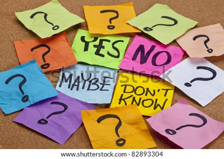 yes, no, maybe, I do not know - choice or uncertainty concept - colorful sticky notes on a cork bulletin board