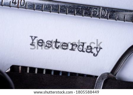 Yesterday - word typed on a vintage typewriter ストックフォト ©