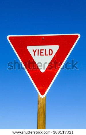 yield Sign at the highway with blue sky