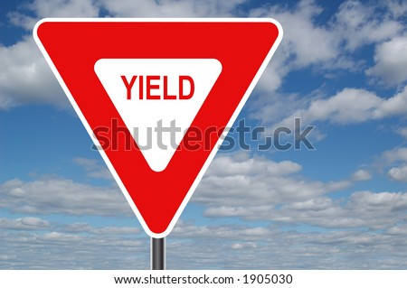 Yield sign with clouds in the background