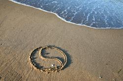 Yin Yang on the beach