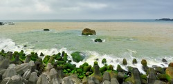 Yin Yang Sea, Ruifang, Taiwan. A tourist spot where the sea water is a mix of yellow and blue.