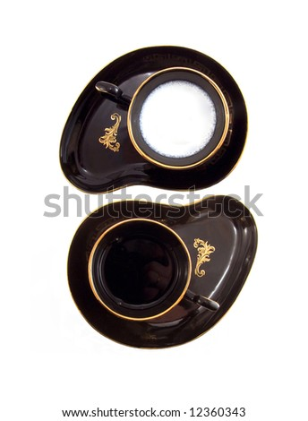 Yin Yang sign made of two coffee cups (with milk and black coffee)