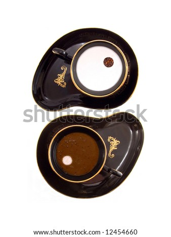 Yin Yang sign made of two coffee cups (with milk and cocoa)
