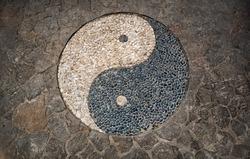 Yin Yang Symbol in mosaic stone floor