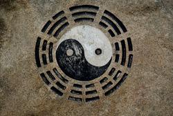 Yin yang symbol on sand rock in China