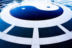 Yin Yang symbol on tiled floor,black and white Yin Yang sign