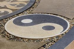 Ying yang symbol on walkway