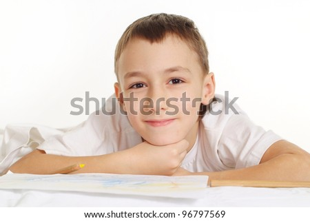 yjinking boy on white floor with a pen