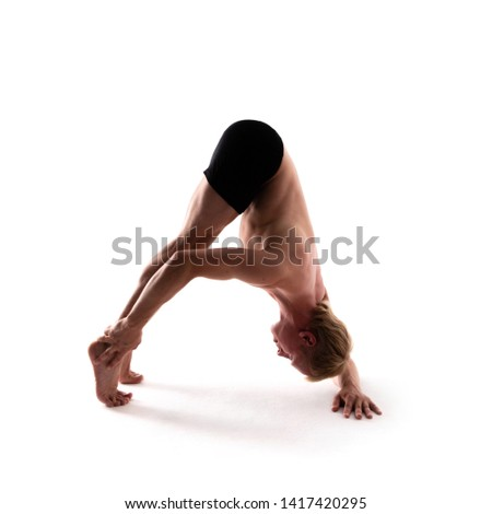 Yoga alphabet. The letter A formed by gymnast body