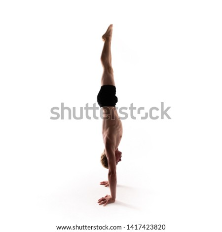 Yoga alphabet. The letter I formed by gymnast body