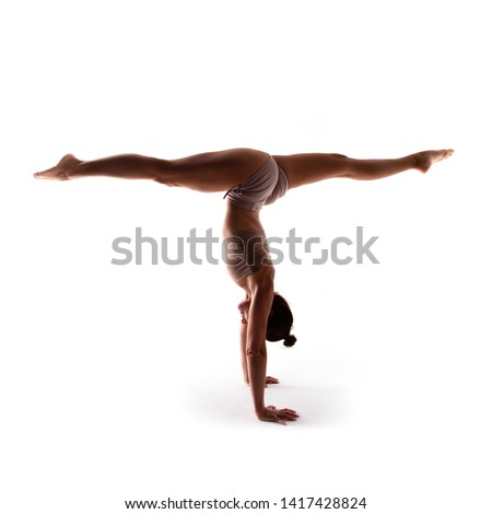 Yoga alphabet. The letter T formed by gymnast body