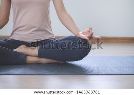 Yoga and meditation lifestyles. close up view of young beautiful woman practicing yoga namaste pose in the living room at home. ストックフォト ©