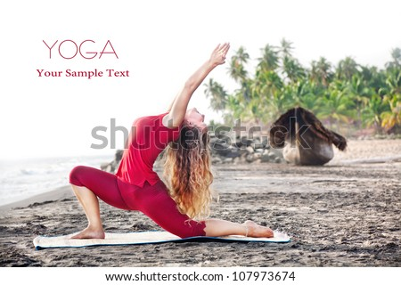 Yoga Ashva Sanchalanasana pose by young woman with long hair in red cloth on the beach near the ocean at palm tree and boat background. Free space for your text