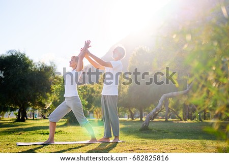 Yoga at park. Senior family couple exercising outdoors. Concept of healthy lifestyle. #682825816