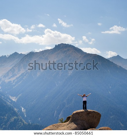 Yoga at summit with aerial view of the mountain range