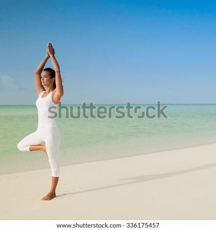 yoga beach woman doing pose