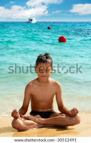 Yoga boy are sitting in lotus position